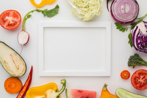 White empty frame with arrangement of vegetables Free Photo
