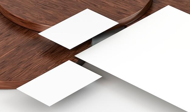Documenti cartacei vuoti bianchi e tavola di legno Foto Gratuite