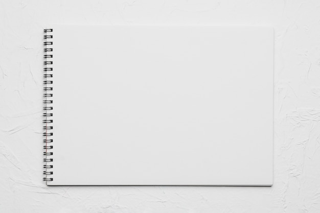 White empty sketchbook on rough surface Free Photo