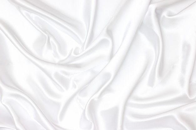 White fabric texture background. smooth elegant white silk can use as wedding background. Premium Photo