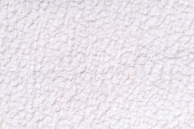 White fluffy background of soft, fleecy cloth Premium Photo