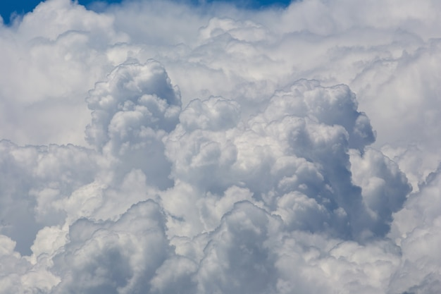 White fluffy clouds in the blue sky background Premium Photo