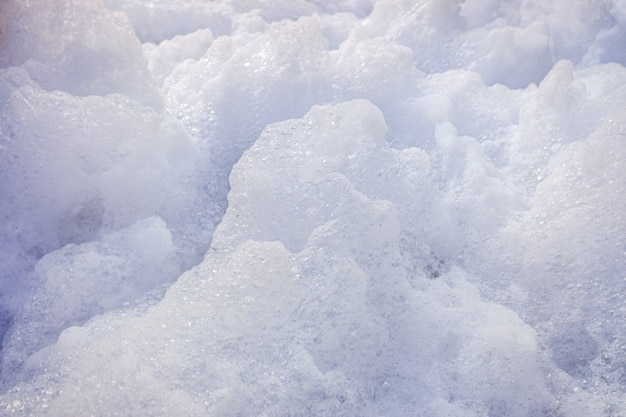 White foam of an isolated soap to use as a background. Premium Photo