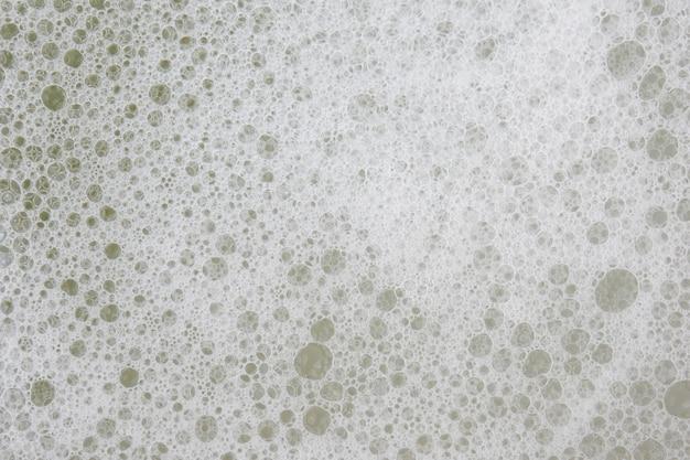 White foam texture abstract background closeup Premium Photo