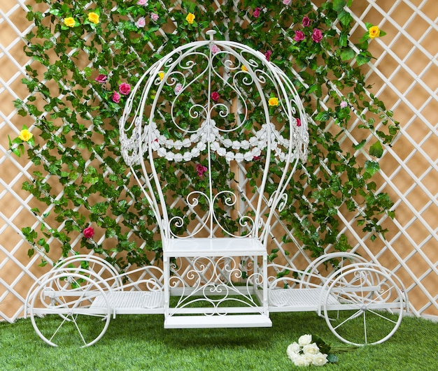 White forged a coach in the blooming garden Premium Photo