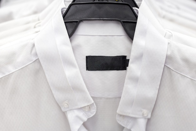 White formal shirts hanging on a hanger Premium Photo