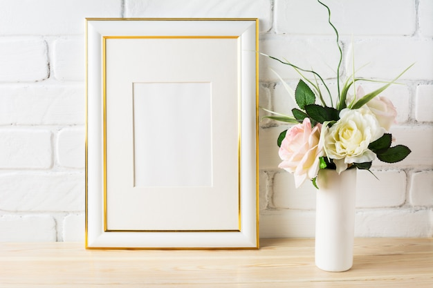 White frame mockup with pale pink roses in vase Premium Photo