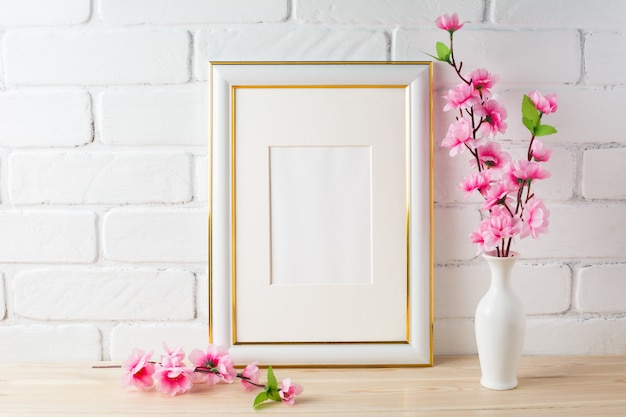 White frame mockup with pink flower bunch Premium Photo