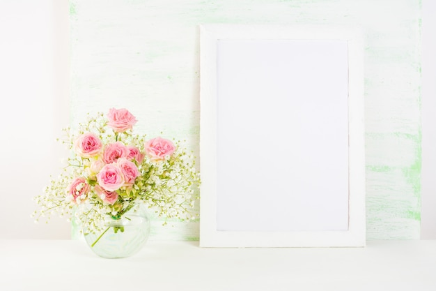 White frame mockup with  pink rose flowers Premium Photo