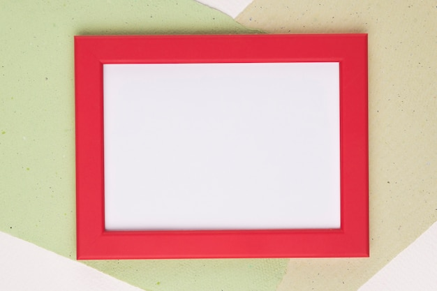 White frame with red border on paper background Free Photo