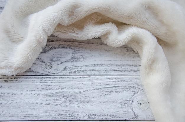 White fur on a wooden background Premium Photo