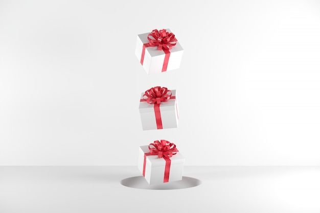 White gift box with red ribbon color floating on white background Premium Photo