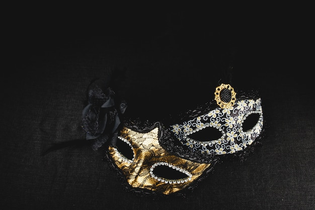 White and golden mask on a dark background Free Photo