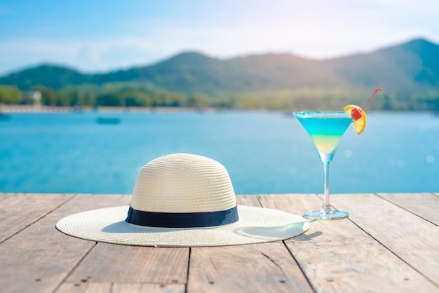 White hat and summer drinking on beach Premium Photo
