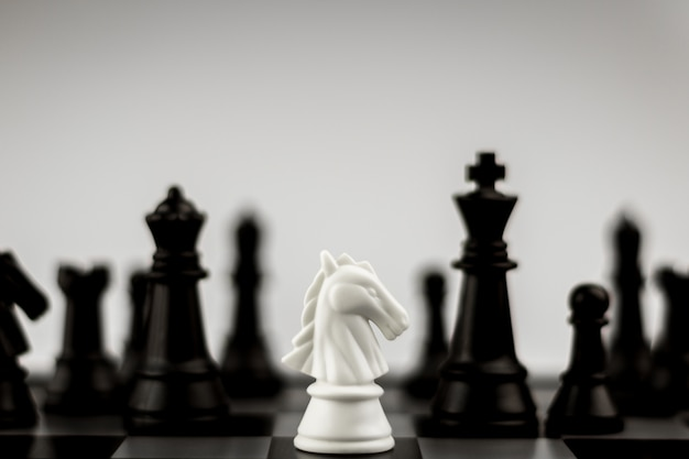 White horse chess figures on board Premium Photo