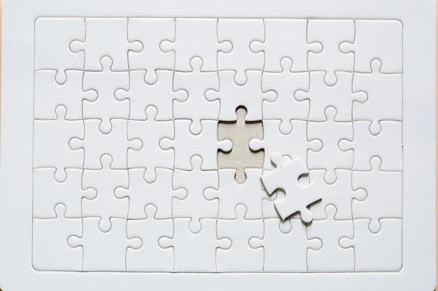White jigsaw puzzle Free Photo