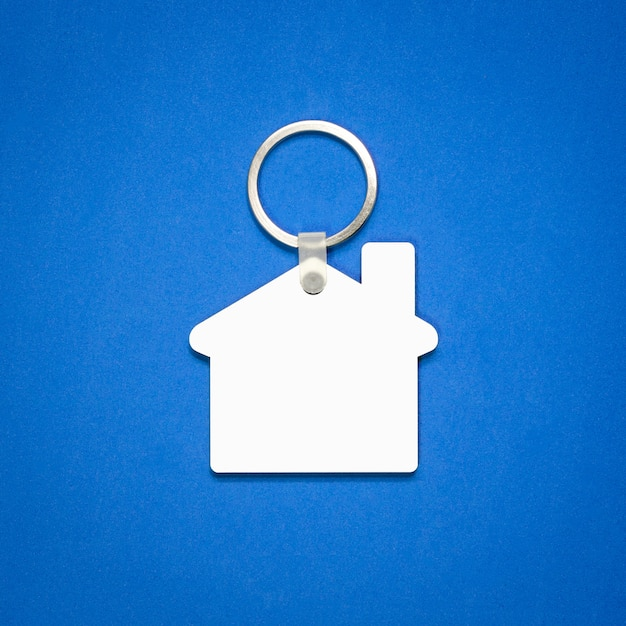 White key ring on blue background. Premium Photo