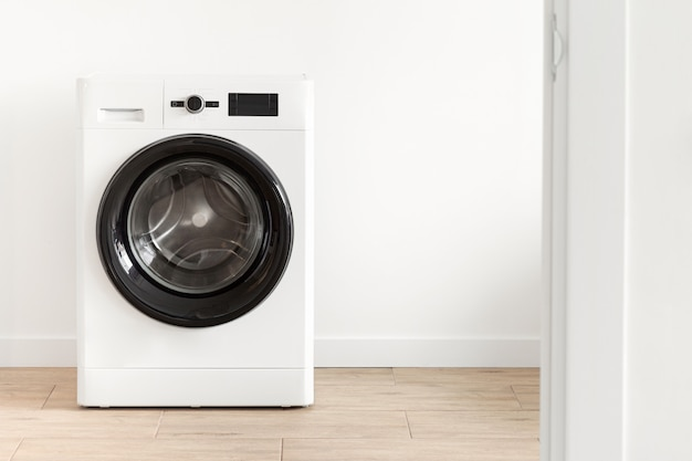 White Laundry Room With A Washing Machine Premium Photo