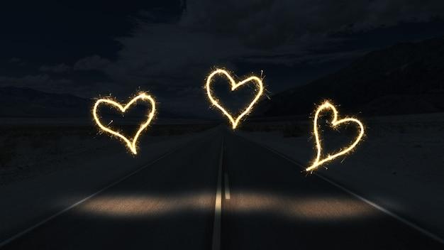 어둠 속에서 마음을 형성하는 백색광 무료 사진