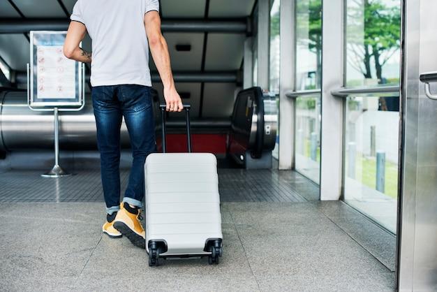 White man carrying luggage Free Photo
