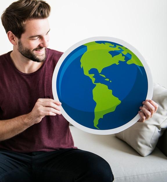 White man holding globe icon Free Photo