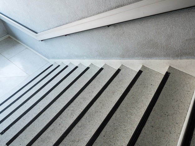 White marble pattern staircase with the metal handrail. Premium Photo