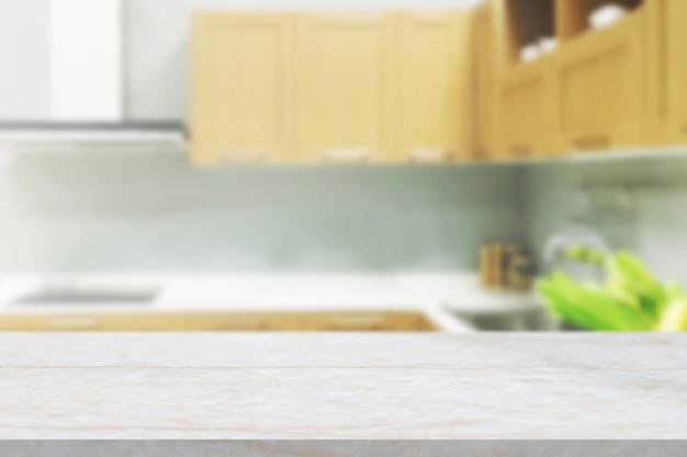 흐리게 부엌 배경으로 흰색 대리석 돌 카운터 탑 프리미엄 사진