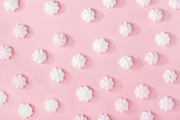 White marshmallows on pink Free Photo