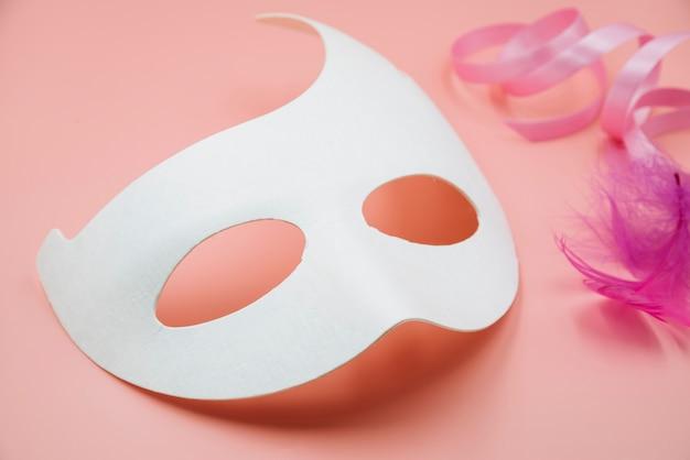 White mask mockup with feathers Free Photo