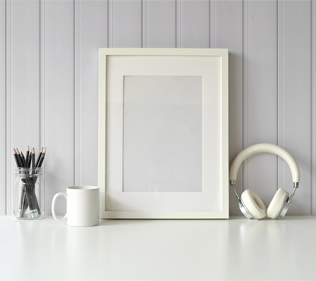 White mock up frame and gadget on white table. Premium Photo