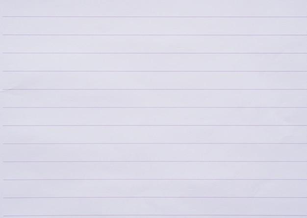 白いノートの紙のラインは背景をクローズアップ Premium写真