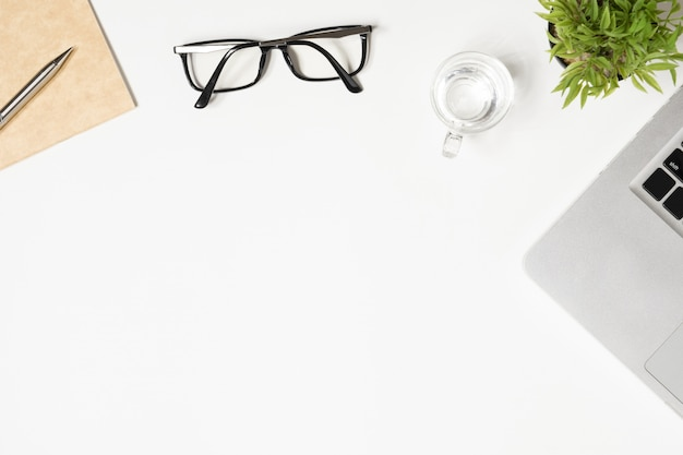 White office desk table with a lot of things on it. top view with copyspace, flat lay. Premium Photo