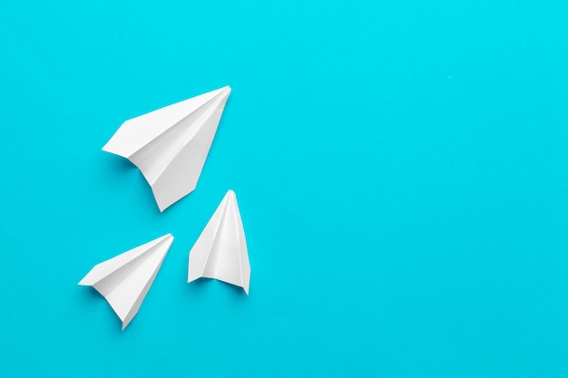 White paper airplane on a blue Premium Photo