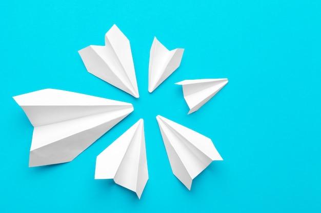 White paper airplane on a blue Premium Photo