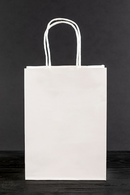 White paper bag on black background Free Photo