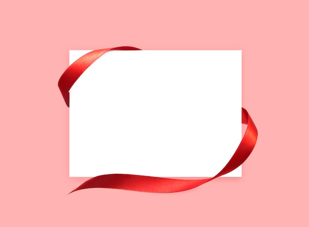 White paper card with red satin ribbon. Premium Photo