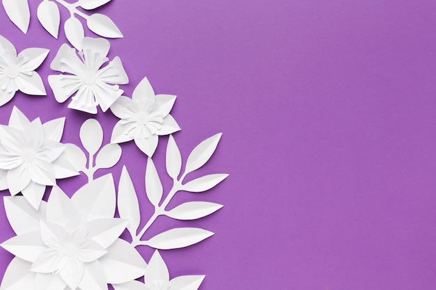 White paper flowers on purple background Free Photo