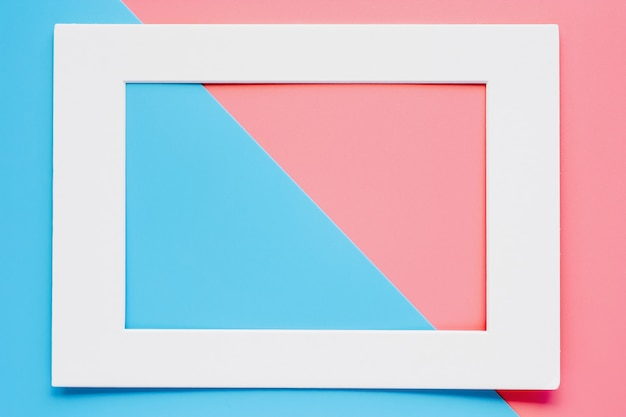 White paper frame on pink-blue pastel color background Premium Photo