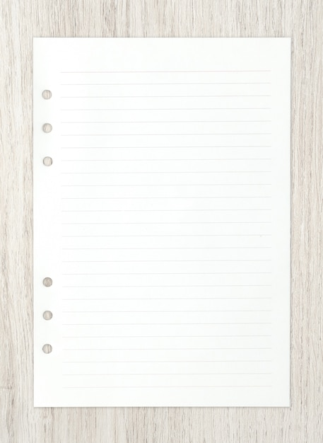 White paper sheet on wood for ackground. Premium Photo