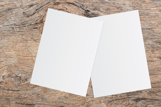 White paper and space for text on old wooden background Premium Photo