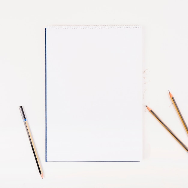 White paper with pencils Free Photo