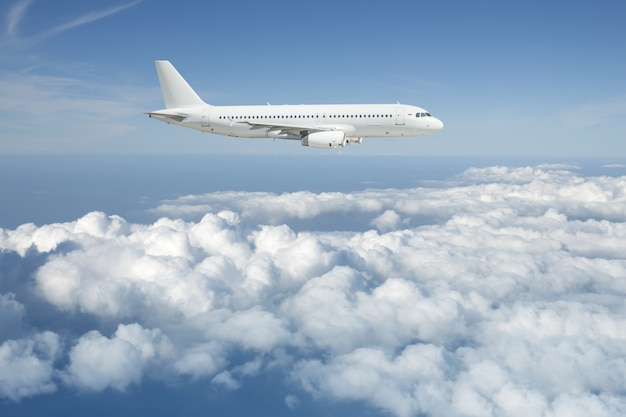 White passenger airplane is flying over the cloudy sky. Premium Photo