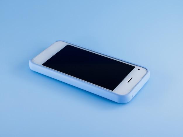 White phone in blue case Premium Photo