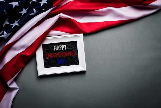 White picture frame with flag of the united states of america on wood Premium Photo