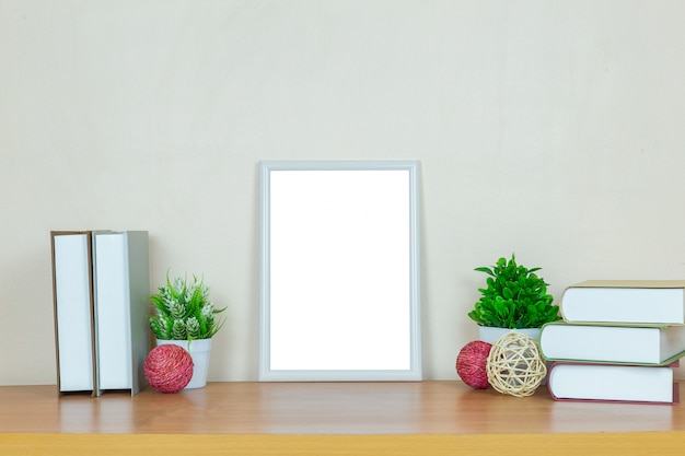 White picture frame on wood table. Premium Photo