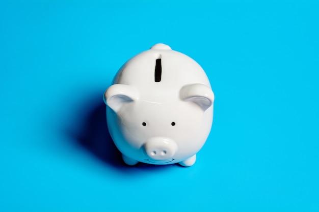 White piggy bank. - save and management concept. Premium Photo