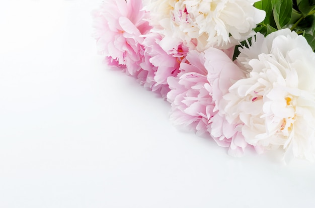 White and pink peonies on a white table Premium Photo