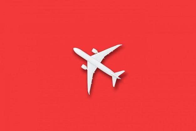 White plane model on red table Premium Photo