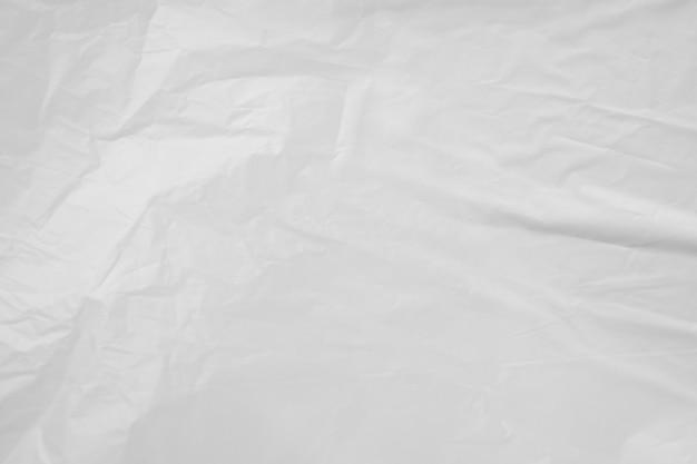 白いビニール袋の背景のテクスチャをクローズアップ Premium写真