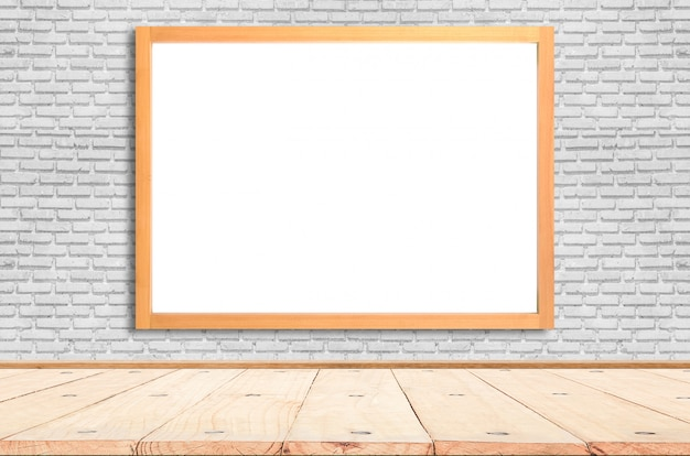 White poster with wood frame mockup on brick wall. mock up. Premium Photo